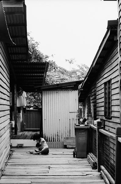 Woman In The Boarded Courtyard @ Malaysia
