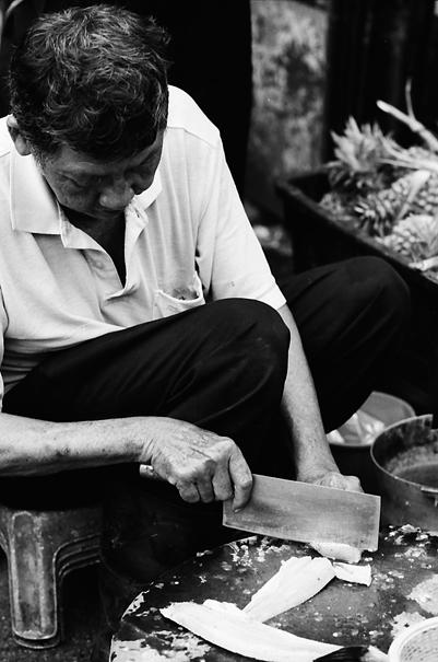 Man Was Cutting A Fish (Malaysia)