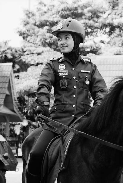 Female trooper wearing hijab