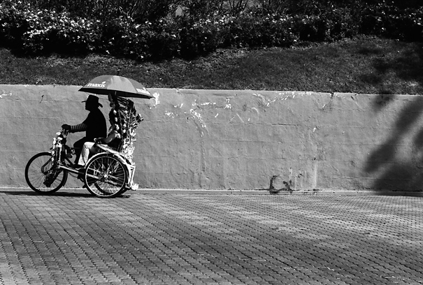 Trishaw Goes With An Umbrella (Malaysia)