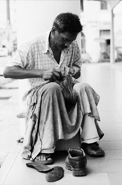 Shoemaker Was Repairing @ Malaysia