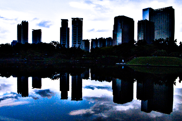 Buildings being reflected in pond