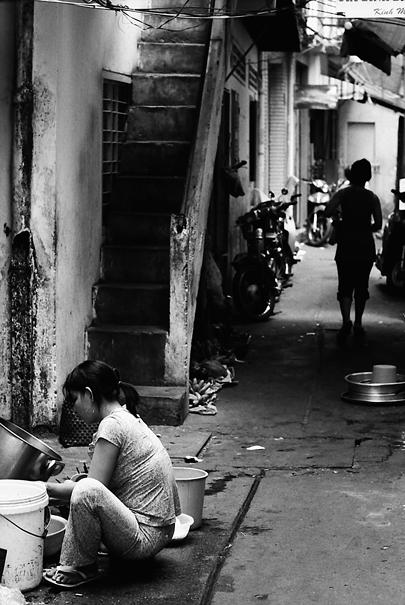 Woman doing housework in dim lane