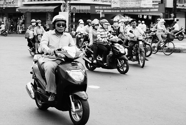 Many motorbikes running street