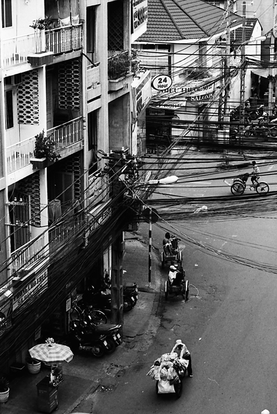 Cyclo And Peddlers On The Street (Vietnam)