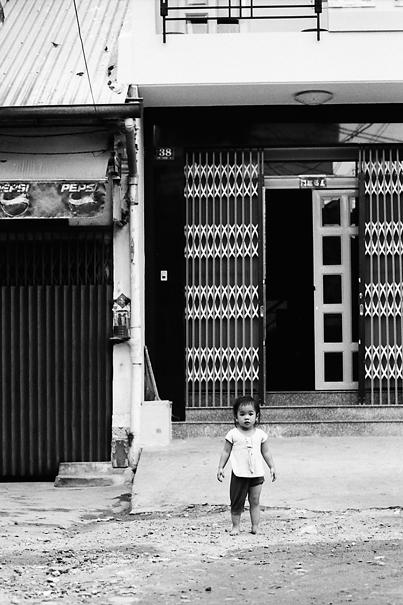 Little girl standing still alone