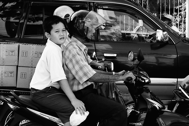 Father and son on motorbike