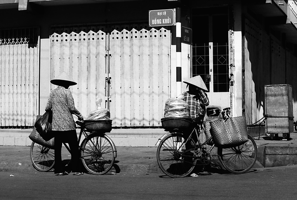 Two Bicycles And Tow Conical Hats (Vietnam)