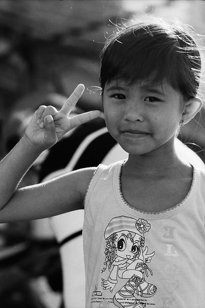Girl Throwing A Deuce (Vietnam)