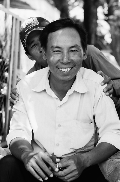 Smiling Man And His Mischievous Friend (Vietnam)