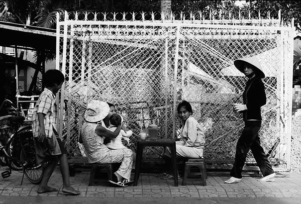 People Around A Plastic Table On The Sidewalk @ Vietnam