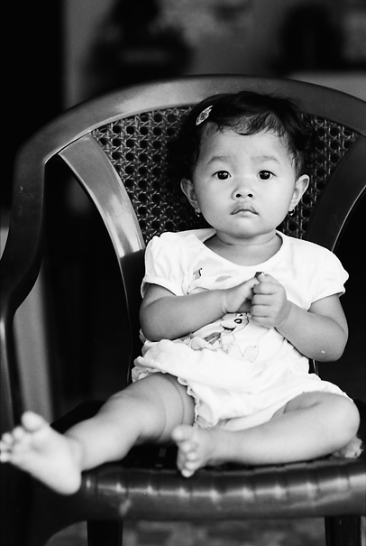 Baby With A Blank Face On The Chair (Vietnam)