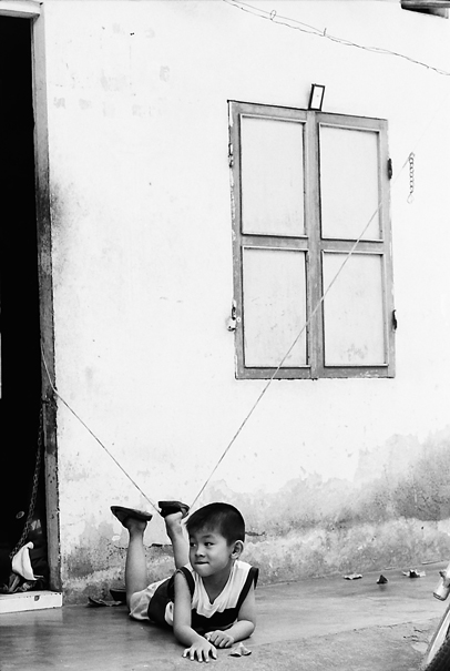 Boy Lying Down On The Floor (Vietnam)