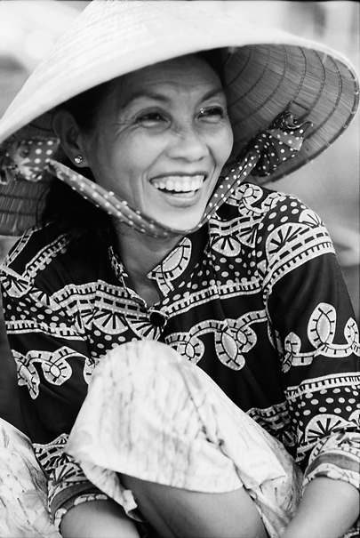 Woman With A Conical Hat Laughs (Vietnam)