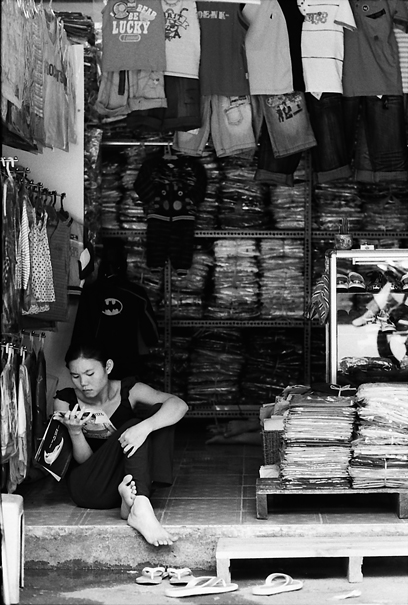 Reading A Magazine In The Shop (Vietnam)