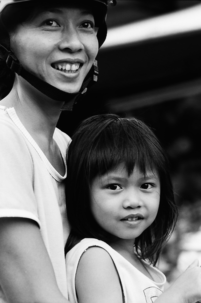 Mother And Her Daughter Cuddling Up Together @ Vietnam