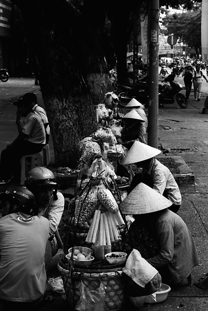 Conical Hats On The Sidewalk (Vietnam)