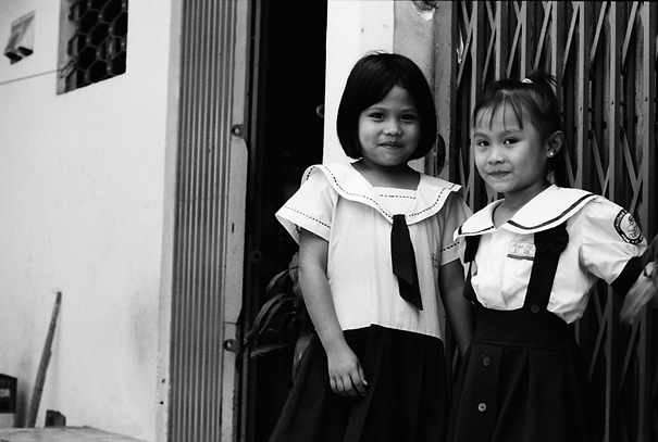 Two Uniformed Girls In The Lane (Vietnam)