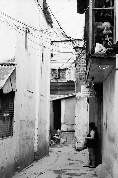 Woman Standing By The Wall @ Vietnam