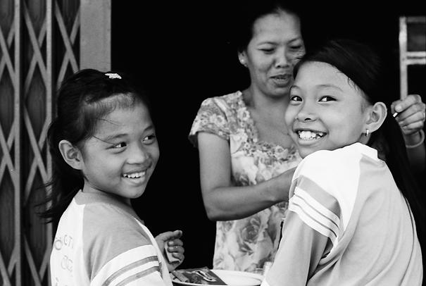 Girls buying snack in street stall