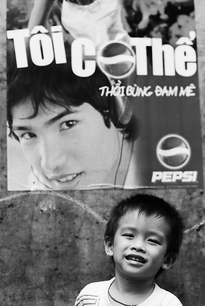Grinning Boy In Front Of A Poster (Vietnam)
