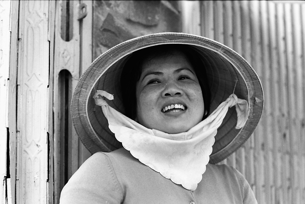 Woman Wearing A Conical Hat In The Market (Vietnam)