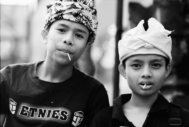 Boys sucking lollipop