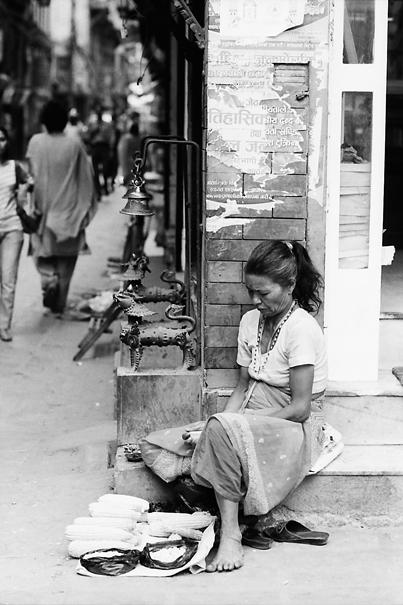 Woman selling corns