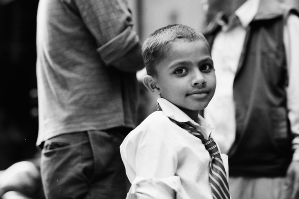 Boy looking back in crowd