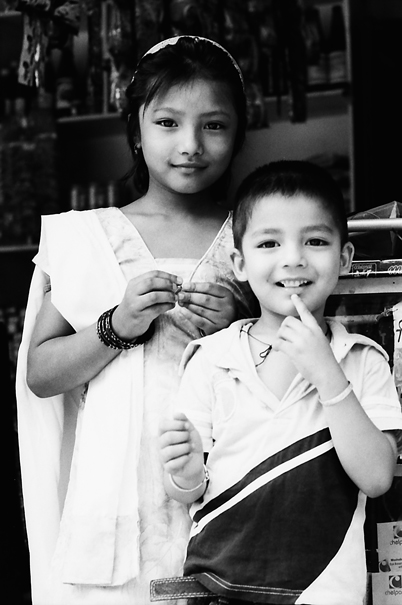 Boy And Girl In A General Store (Nepal)