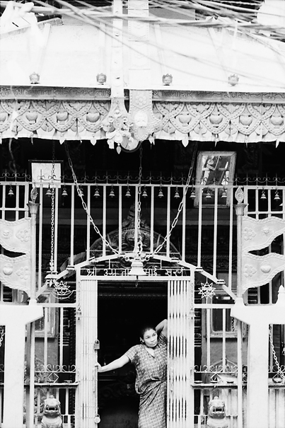 Woman standing at entrance of Hindu temple