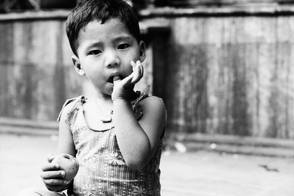 Kid licking finger