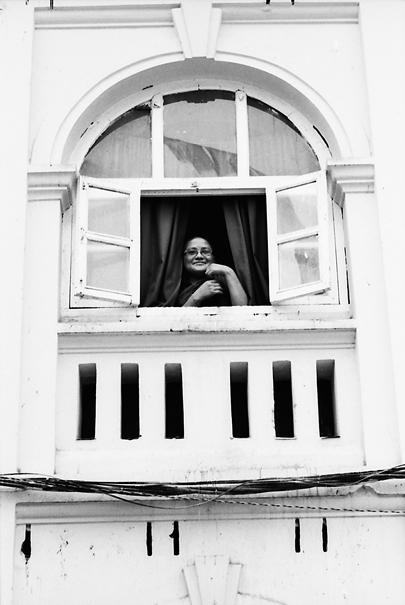 Buddhist monk by window