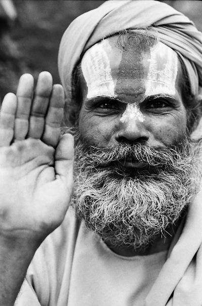 Sadhu replying with hand raise