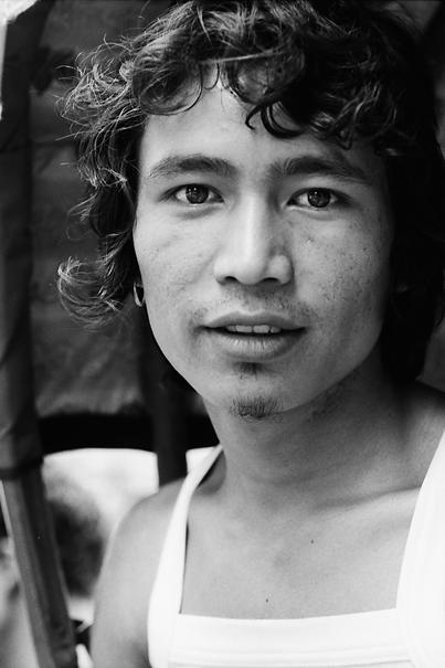 Rickshaw wallah with curly hair