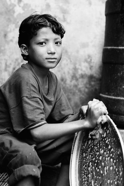 Boy washing dish