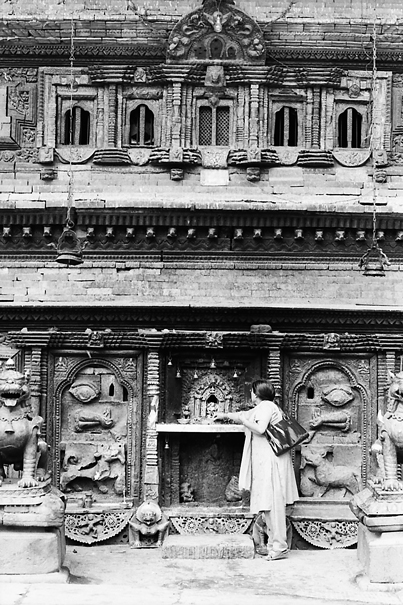 Woman standing in front of altar dedicated to Bhairab