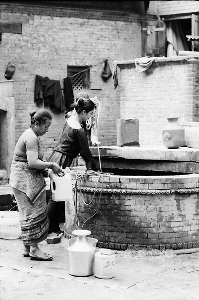 Women Drawing Water From A Well (Nepal)