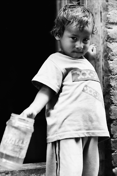 Little Kid With A Plastic Contsiner @ Nepal