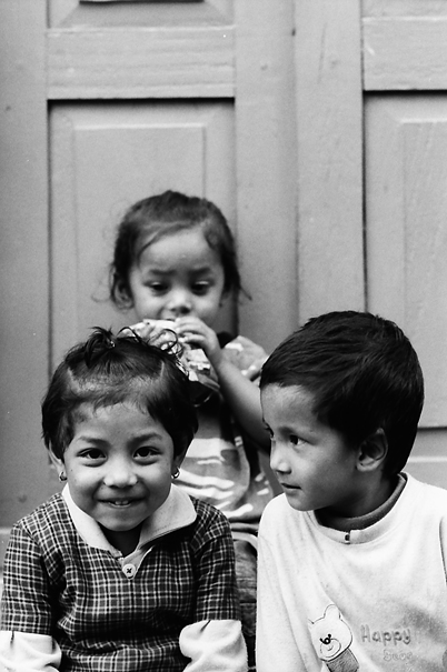 Three Kids Sitting In The Lane (Nepal)
