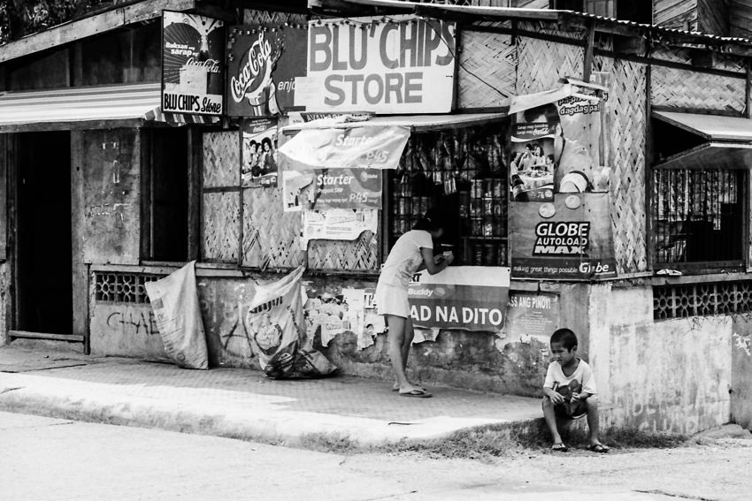 Woman and boy in front of store