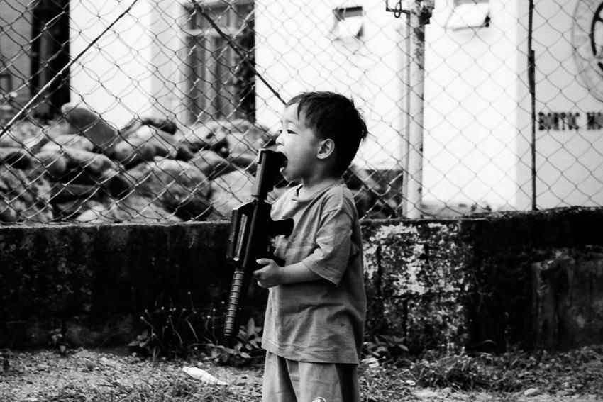 Boy holding gun in mouth