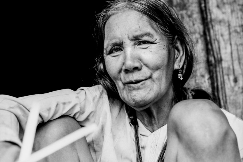 Older woman wearing eye-catching earrings