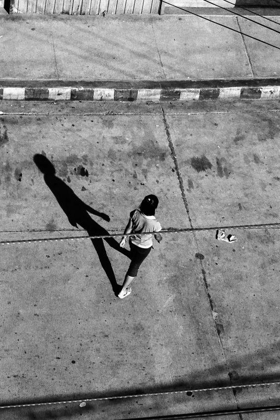 Long shadow of crossing woman