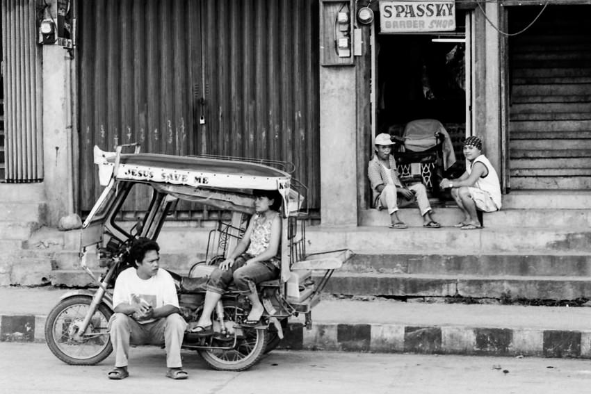 Local people relaxing by roadside