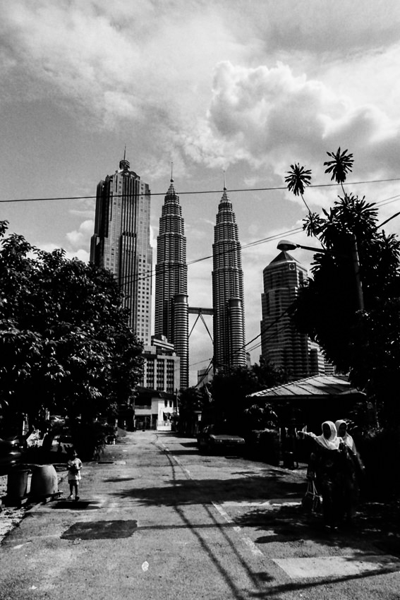 Petronas Twin Towers at end of street