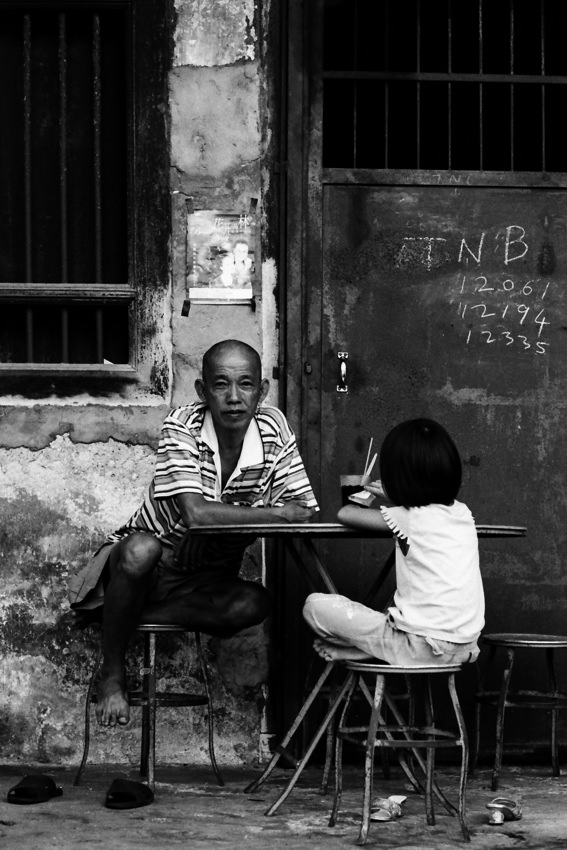 Man sitting at table with daughter