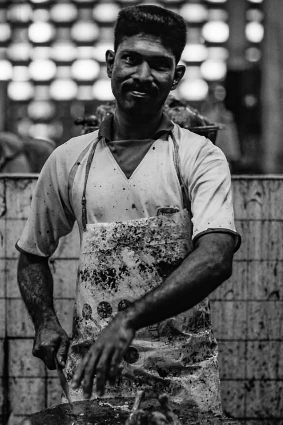 Butcher wearing dirty apron