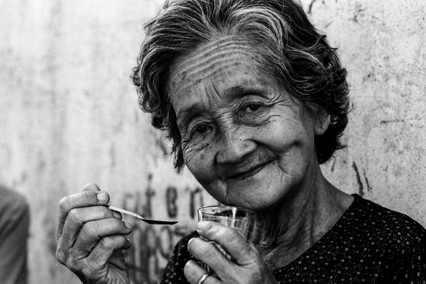 Older woman holding spoon