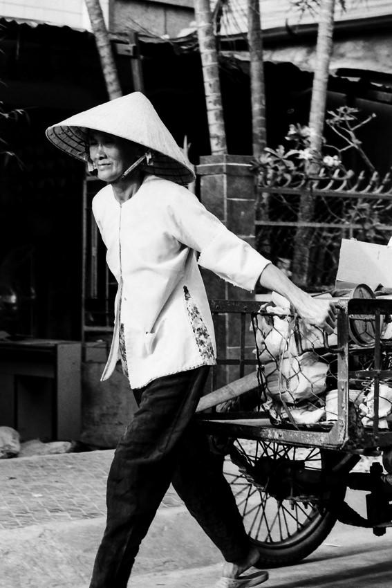 Woman pulling cart